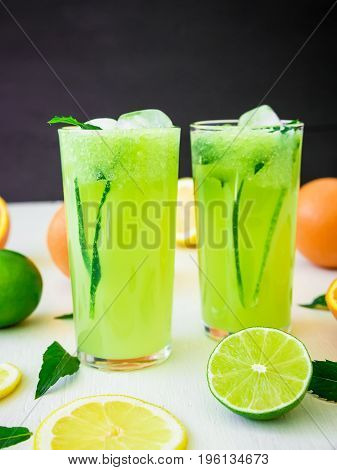 Tasty refreshing drink with cucumber with lime and orange
