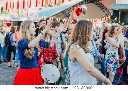 Moscow Russia - April 24 2016: People dancing around the stage of the Yagura the dance of Bon Odori at the japanese festival.