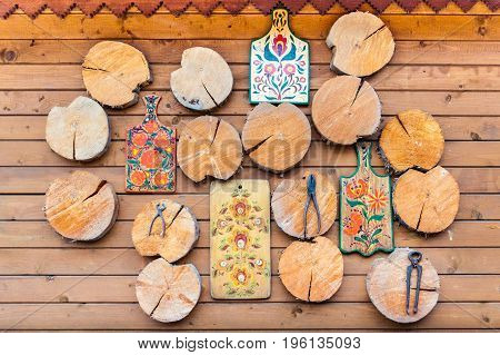 Wooden coasters hanging on the wooden wall