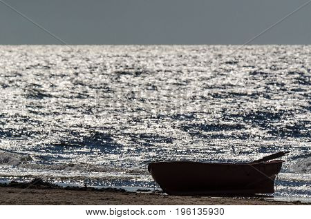 LIFEBOAT - On the sea shore at sunset