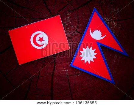 Tunisian Flag With Nepali Flag On A Tree Stump Isolated