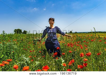 Young Woman Posing In Red Poppies Field