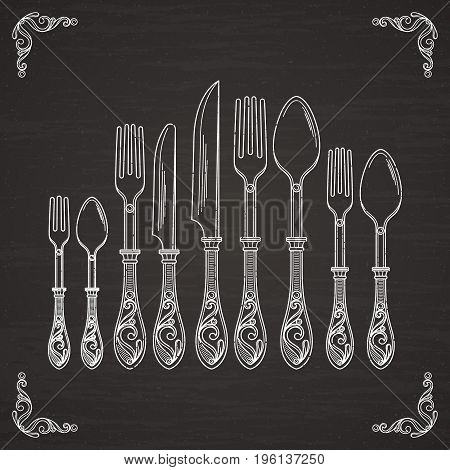Vector pictures of spoon, fork and knife. Tableware hand drawing silhouette on black chalkboard. Fork and spoon, knife for dinner table sketch illustration