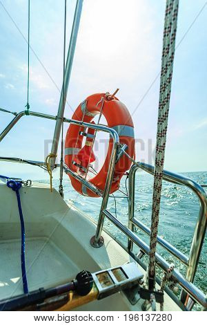 Rescue Red Lifebuoy Life Preserver Saver Ring On Sailboat