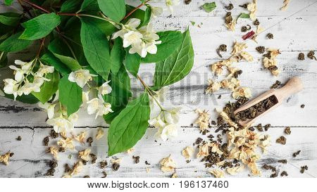 Scattered Green Tea Leaves With Jasmine Flowers