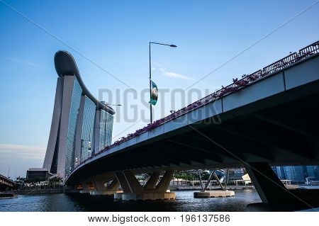 SINGAPORE - JUNE 17 2014 : Bridges and road to Marina Bay Sands Hotel Singapore