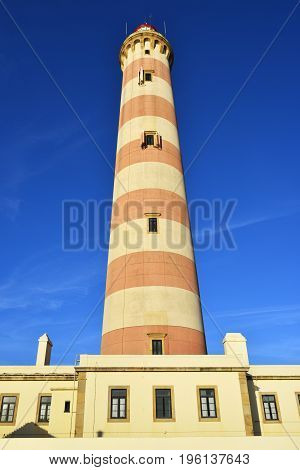 Beautiful view on the Lighthouse Farol da Barra in Praia da Barra resort at sunset famous resort in Portugal