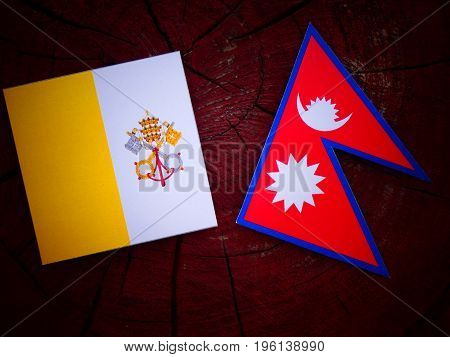 Vatican Flag With Nepali Flag On A Tree Stump Isolated
