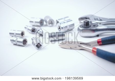Flat lay of repairman equipments and tools white background copy space