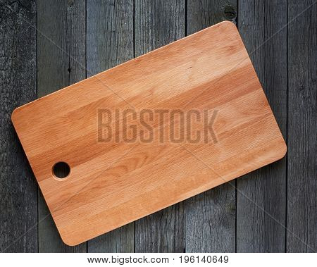 Cutting Board With Space For Text On Old Wooden Background. Close-up