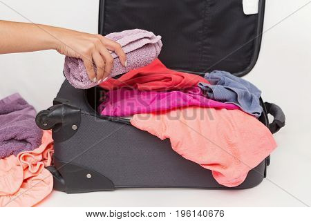Woman Packing Her Carry On With Clothes