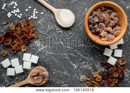 lumps of sugar with bowls on dark kitchen table background. top view mock-up