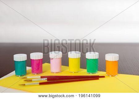 Various Art Supplies On A Wooden Desk