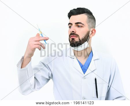 Man With Serious Face In Hospital Gown And Surgical Mask