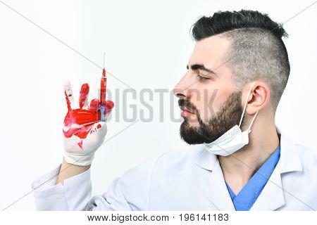 Man With Beard In Medical Uniform Holds Syringe
