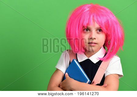 School Girl In Wig With Surprised Face On Green Background