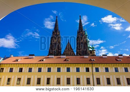 Domes of St. Vitus Cathedral tower in sunny sky Prague