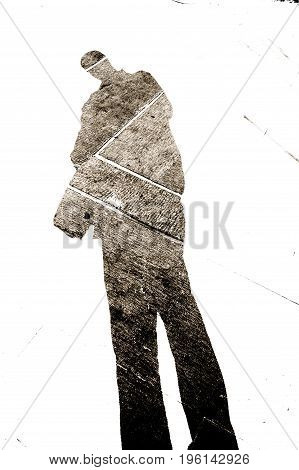 shadow of a figure cast on gravel