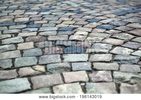 Abstract background of old cobblestone pavement close up