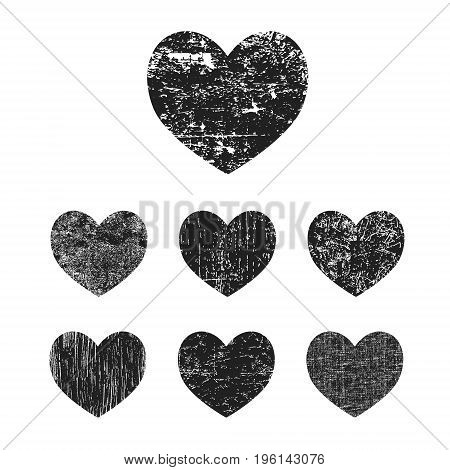 Grunge heart collection. Set of black grunge hearts isolated on white background. Vector illustration.