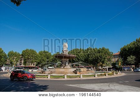 Aix-en-Provence, France - July 09, 2016. Roundabout and fountain in Aix-en-Provence, a lively town in the French countryside. In the Bouches-du-Rhone department, Provence region, southeastern France