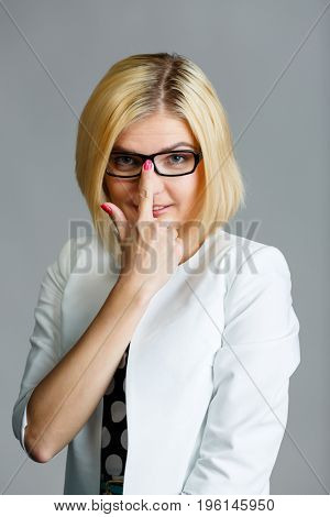 Beautiful young girl adjusts glasses