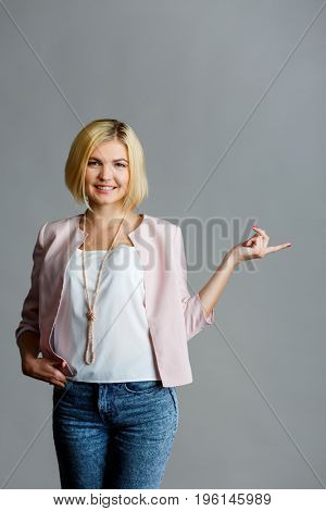 Blonde pointing at empty space