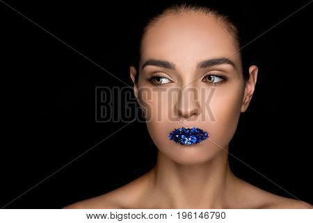 Attractive Fashionable Woman With Blue Sparkles On Lips, Isolated On Black