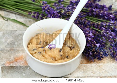 Homemade body scrub good for clear soft skin. Made from granulated sugar bamboo butter coconut oil and lavender flowers