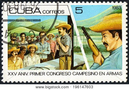 UKRAINE - CIRCA 2017: A postage stamp printed in Cuba shows Farmers from the series 25th anniversary of the Congress of the armed farmers circa 1983