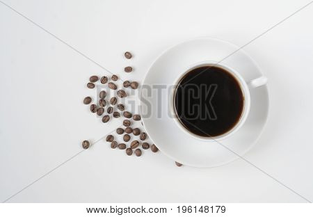 Coffee cup isolated on white with coffee beans. Top view, place for your text. Copy space for your ideas.