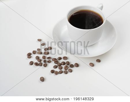 Coffee cup isolated on white with coffee beans. Drink abstract.