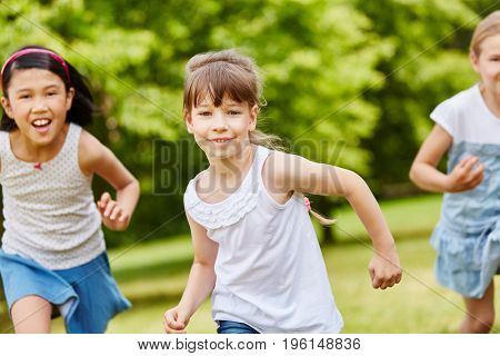 Group of kids running in the park during kindergarden race