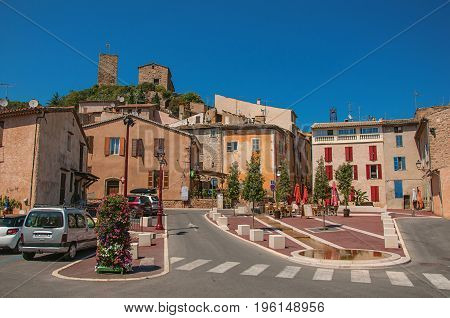 Les Arcs-sur-Argens, France - July 10, 2016. View of square with houses and ancient town on the hill, at the gorgeous medieval hamlet of Les Arcs-sur-Argens. Provence region, Var department, southeastern France