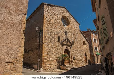 Stone made facade of ancient church in Châteaudouble, a quiet and tourist village with medieval origin on a sunny summer day. Located in the Var department, Provence region, southeastern France