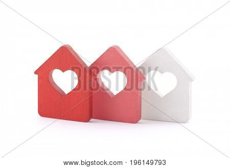 Three small houses with heart on white background