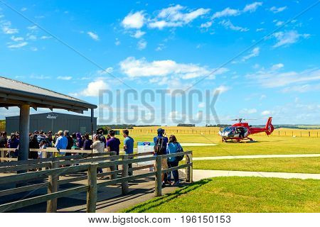 Princetown Victoria Australia - December 30 2016: People queued up in line for scenic 12 Apostles Helicopters ride above Bay of Islands via London Bridge on a bright day.
