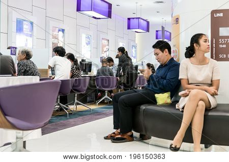 Siam Commercial Bank, Bangkok, Thailand - July 10, 2017: People waiting in financial transactions in the bank.