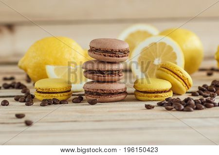 Yellow And Brown French Macarons With Lemons And Coffee Beans