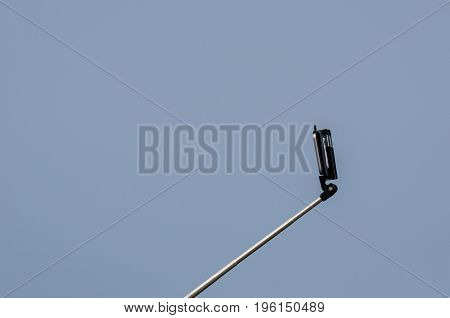 SMARTPHONE - Mobile phone on the handle of the selfi