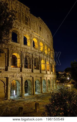 ROME ITALY - 21 JUNE 2017 - Evening scene of light shining through the arches of the impressive Colosseum amphitheatre in Rome