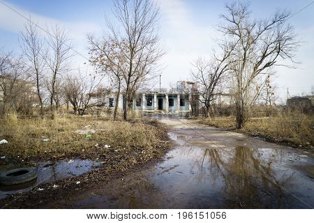 Littered abandoned city with empty ruined buildings