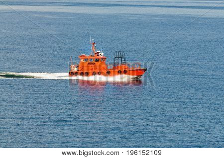 Copenhagen, Denmark-July 14, 2017: Pilot boat cruising by bringing the pilot to a ship
