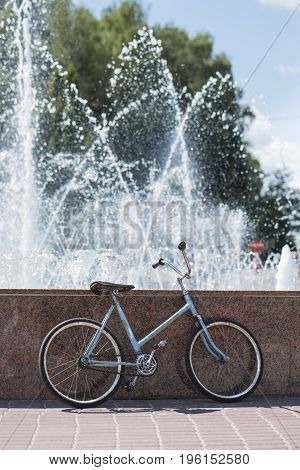 Bicycle near the fountain. Summer hot day.