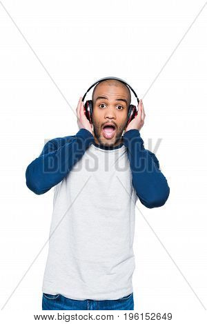Shocked Young African American Man Listening Music In Headphones And Looking At Camera Isolated On W