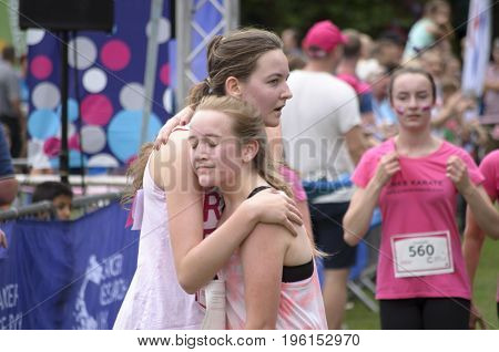 COLCHESTER, ESSEX, ENGLAND, UK- 16 JULY 2017-  Celebration at the finish line of Race for Life. This annual race is run by women and children to raise money for Cancer Research.