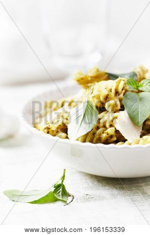Fusilli pasta with olive-basil pesto and parmesan