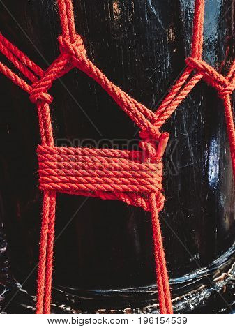 Knots from red ropes of taiko drums o-kedo background. Musical instrument of Asia.