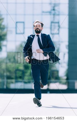 Handsome Bearded Mature Businessman In Suit Running On The Street