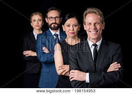 Confident Multiethnic Group Of Businesspeople Standing With Crossed Arms And Looking At Camera Isola
